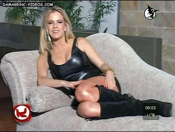 Sexy blonde in black latex uniform