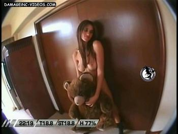 Topless Lara having sex with a teddy bear
